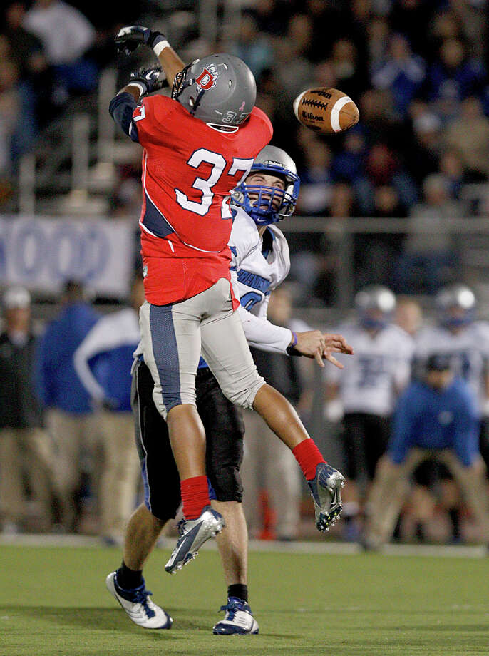 10/26/12: Jordan Wood #8 of the Friendswood Mustangs has his pass knocked down by a Dawson Eagles defender at the RIG in Pearland, Texas. Dawson lead 21 to 20 at half. Photo: Thomas B. Shea, For The Chronicle