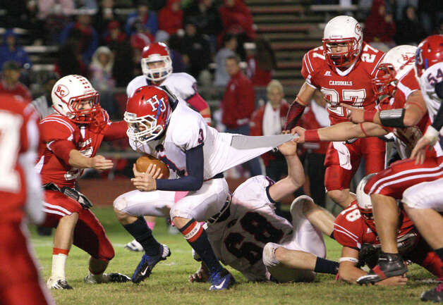 Hardin-Jefferson quarterback Jared Gieseke, No. 3, is tackled by Bridge City s Hunter Stout, No. 5, during the game Friday at Larry Ward Stadium in Bridge City. (Matt Billiot/Special to the Enterprise) / New