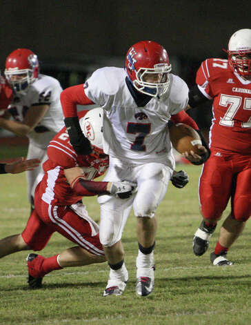 Hardin-Jefferson s Blain Padgett is tackled by a Bridge City player during the game Friday at Larry Ward Stadium in Bridge City. (Matt Billiot/Special to the Enterprise) / New