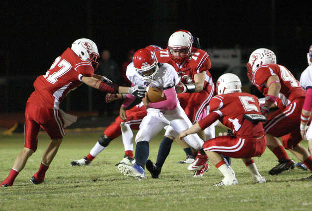 Hardin-Jefferson quarterback Jared Gieseke is tackled by a host of Bridge City defenders during the game Friday at Larry Ward Stadium in Bridge City. (Matt Billiot/Special to the Enterprise) / New