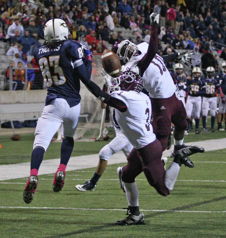 Cy-Fair's Ryan Oakes (3) and Brandon Richmond break up a pass in the end zone intended for Cypress Ranch wide receiver Najee Thomas during the second half of a high school football game, Friday, October 26, 2012 at Berry Center in Cypress, TX. Photo: Eric Christian Smith, For The Chronicle