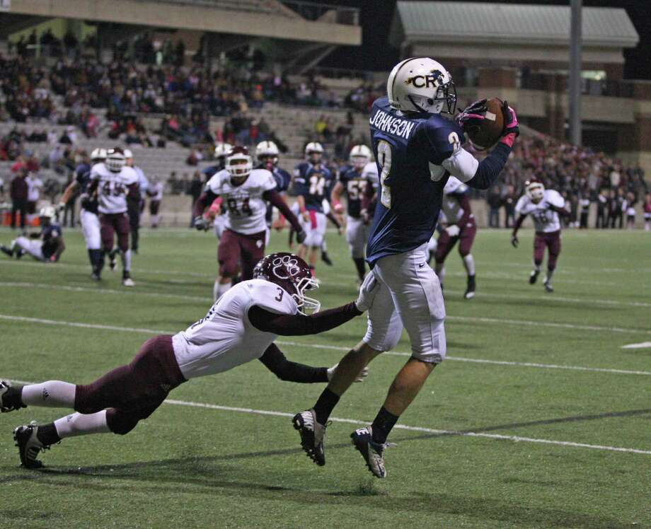 Tied at 21-21, Cypress Ranch wide receiver Bryce Johnson (2) makes the go-ahead touchdown reception past Cy-Fair's Ryan Oakes during the second half of a high school football game, Friday, October 26, 2012 at Berry Center in Cypress, TX. Cypress Ranch won, 31-21. Photo: Eric Christian Smith, For The Chronicle