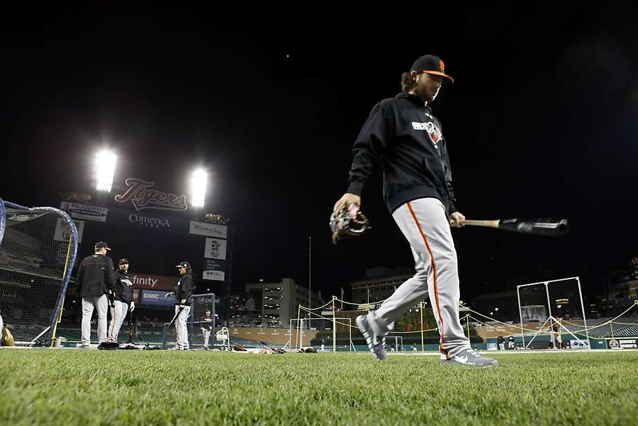 Brandon Crawford inspects the field at Comerica Park, where temperatures Saturday are expected to dip into the 30s. Photo: Carlos Avila Gonzalez, The Chronicle