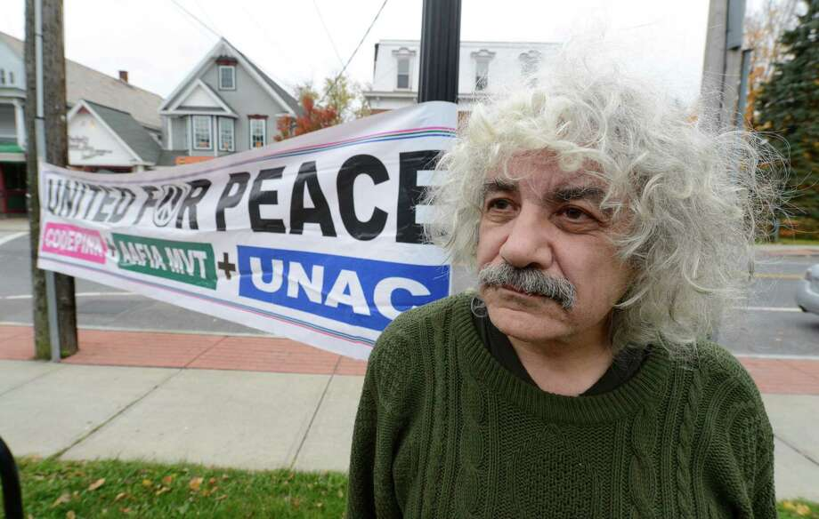 Local peace activist Joe Lombardo with his signage at the corners of Kenwood and Delaware Avenue in Delmar, N.Y.  Oct 26, 2012   (Skip Dickstein/Times Union) Photo: Skip Dickstein / 00019846A
