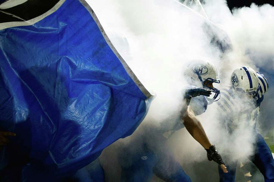 Barbers Hill players take the field before a high school football game against Dayton at Eagle Stadium, Friday, Oct. 26, 2012, in Mont Belvieu. Photo: Smiley N. Pool, Houston Chronicle / © 2012  Houston Chronicle