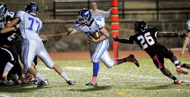 Fairfield Ludlowe's Jimmy Gasper carries the ball during Friday's football game at Stamford High School on October 26, 2012. Photo: Lindsay Niegelberg