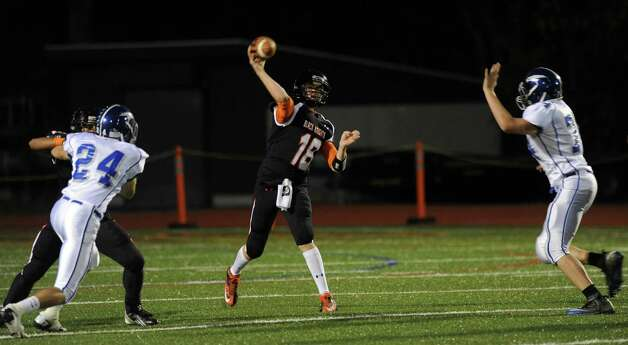 Stamford's Tyler Kane throws a pass during Friday's football game against Fairfield Ludlowe at Stamford High School on October 26, 2012. Photo: Lindsay Niegelberg