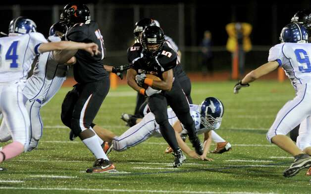 Stamford's Carmeron Webb carries the ball during Friday's football game against Fairfield Ludlowe at Stamford High School on October 26, 2012. Photo: Lindsay Niegelberg
