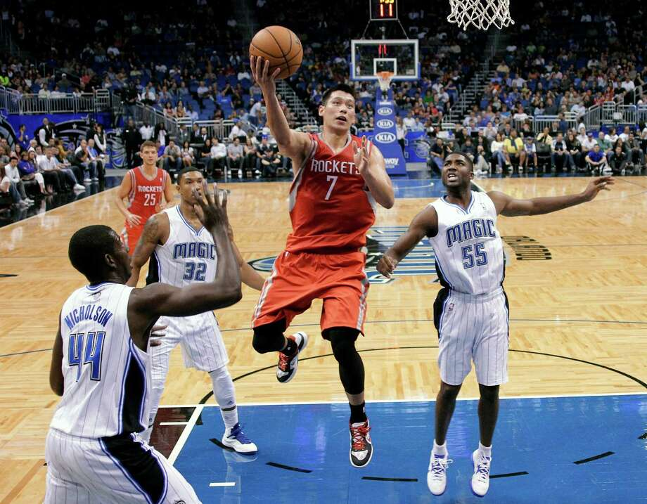 In a break from the strategy he reviewed with coach Kevin McHale, guard Jeremy Lin eschews the chance for a midrange shot in favor of a drive to the basket. Photo: John Raoux, STF / AP