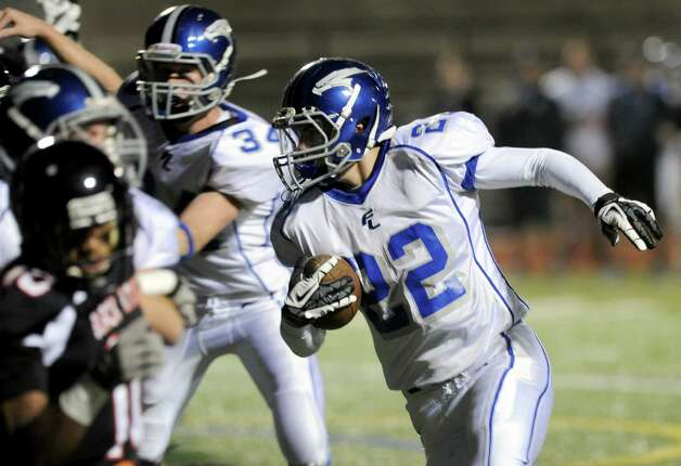 Fairfield Ludlowe's Stephen Scholz carries the ball during Friday's football game at Stamford High School on October 26, 2012. Photo: Lindsay Niegelberg