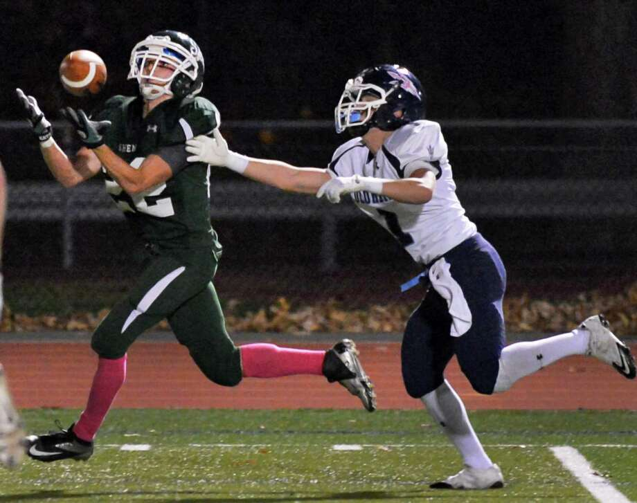 Shenendehowa's #22 Corey Acker, left, out runs Columbia's #1 Connor Kinzelman to complete a touch down pass during Friday night's game in Clifton Park  Oct. 26, 2012.  (John Carl D'Annibale / Times Union) Photo: John Carl D'Annibale / 00019850A