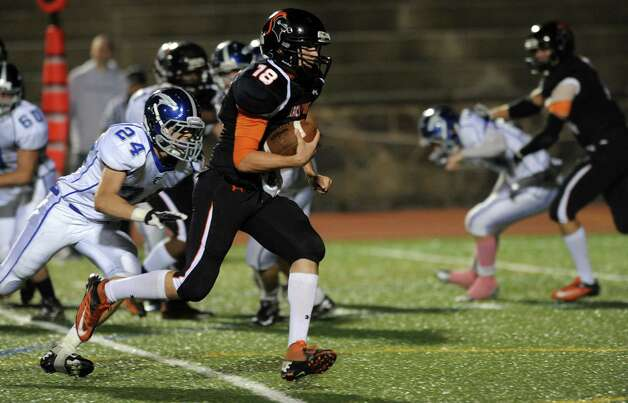 Stamford's Tyler Kane carries the ball during Friday's football game against Fairfield Ludlowe at Stamford High School on October 26, 2012. Photo: Lindsay Niegelberg