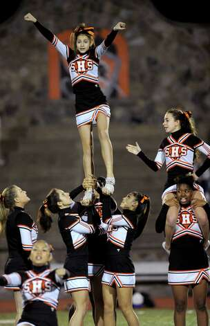 Stamford cheerleaders perform a routine during halftime of Friday's football game against Fairfield Ludlowe at Stamford High School on October 26, 2012. Photo: Lindsay Niegelberg