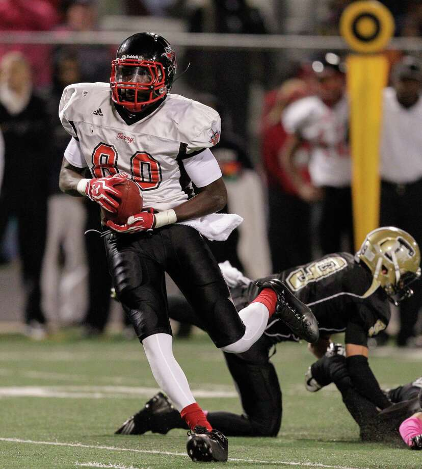 Terry wide receiver Derrick Griffin #80 advances the ball after a reception against Foster during a District 23-4A football game between the Terry Rangers and the Foster Falcons Friday, October 26, 2012. Photo: Bob Levey, Houston Chronicle / Houston Chronicle