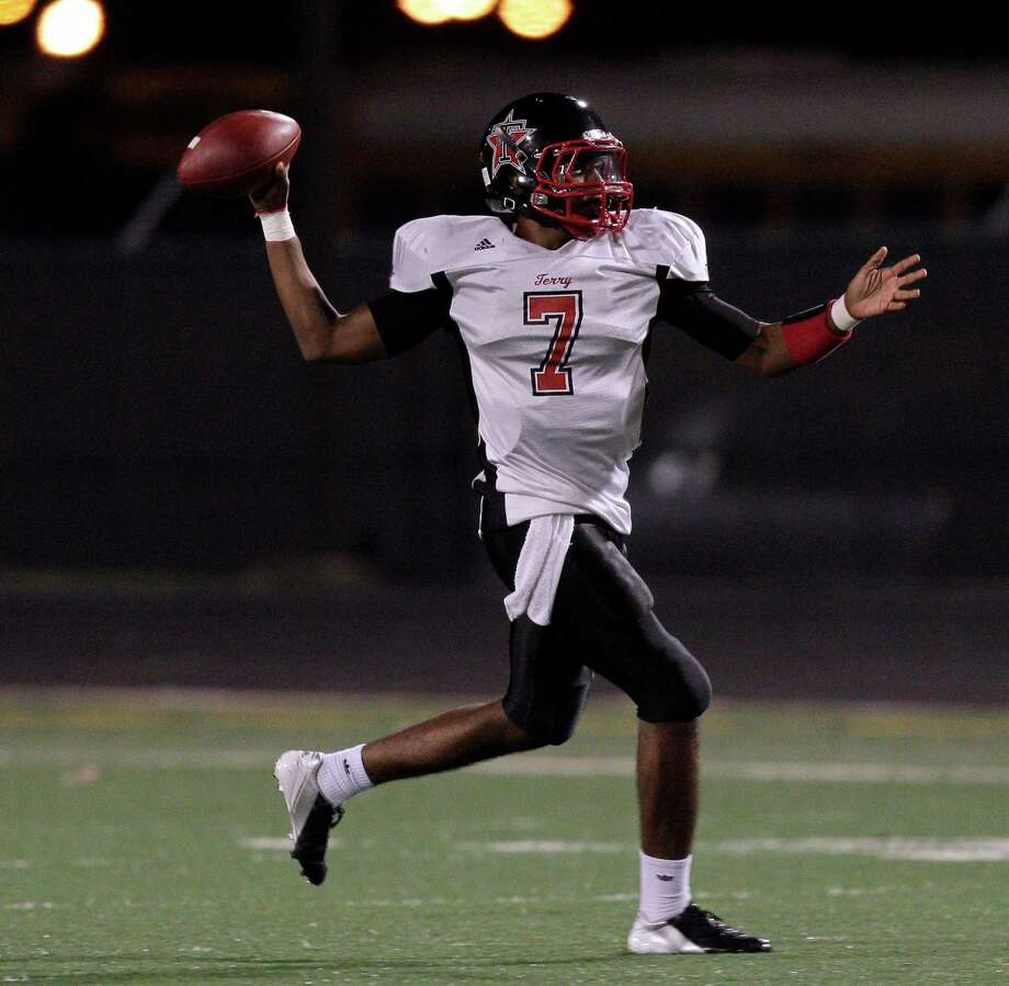 Terry quarterback Antoine Arboleda #7 rolls out against Foster during a District 23-4A football game between the Terry Rangers and the Foster Falcons Friday, October 26, 2012. Photo: Bob Levey, Houston Chronicle / Houston Chronicle