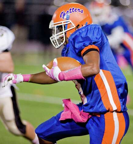 Danbury High School's Corey Acosta carrying the ball during a game against Trumbull High School, at Danbury. Friday, Oct. 26, 2012 Photo: Scott Mullin