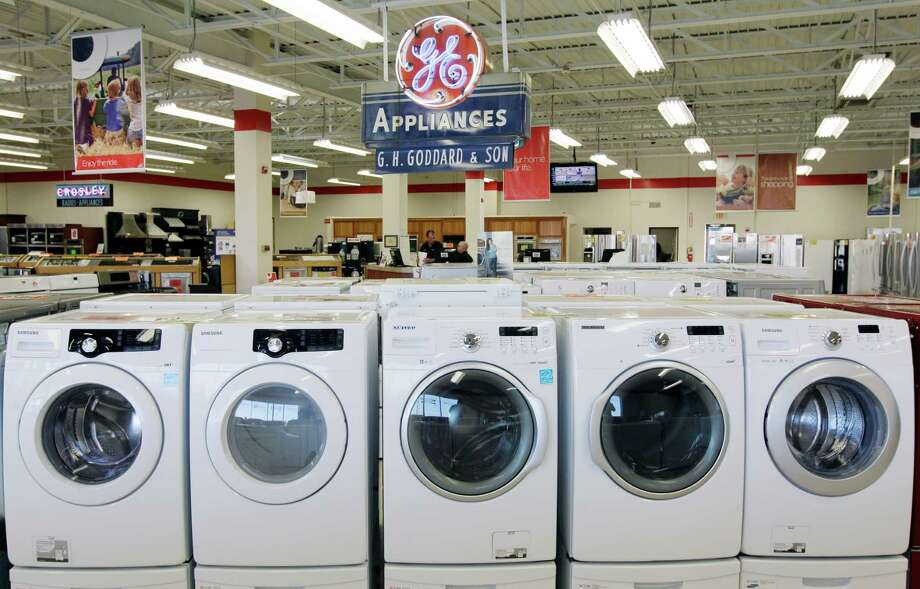 Appliances are on display at Orville's Home Appliances store in Amherst, N.Y. On Friday, the Commerce Department reported the nation's gross domestic product grew by 2 percent from July through September, up from the 1.3 percent rate posted in the second quarter. Photo: David Duprey, STF / AP