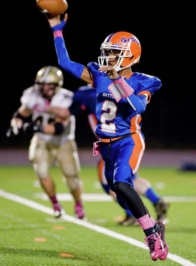 Danbury High School quarterback Elijah Duffy flipping a pass in a game against Trumbull High School, played at Danbury. Friday, Oct. 26, 2012 Photo: Scott Mullin