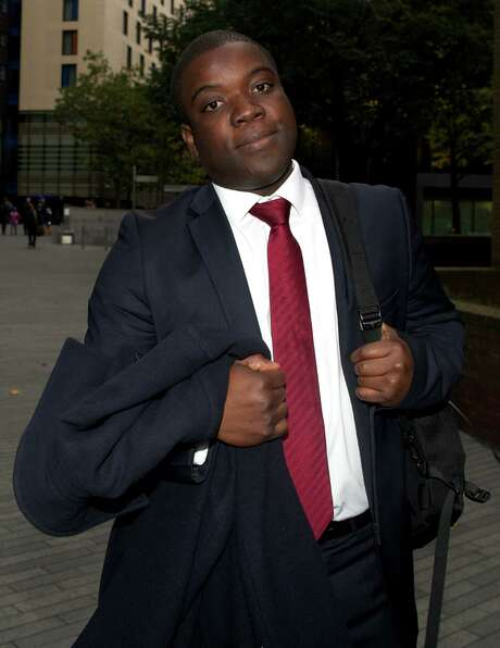 Former UBS banker Kweku Adoboli leaves Southwark Crown Court in London on October 26, 2012 after speaking on the witness stand during his trial on charges of fraud. Kweku Adoboli, the UBS trader accused of losing $2.3 billion (1.78 billion euros), broke down in tears on October 26 as he took to the witness stand for the first time in his trial in London. AFP PHOTO / ANDREW COWIEANDREW COWIE/AFP/Getty Images Photo: ANDREW COWIE, Stringer / AFP