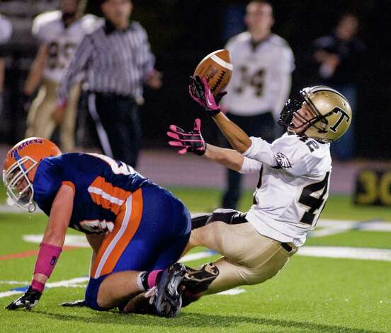 Trumbull High School's Nick DeRosa makes a falling reception during a game against Danbury High School, played at Danbury. Friday, Oct. 26, 2012 Photo: Scott Mullin