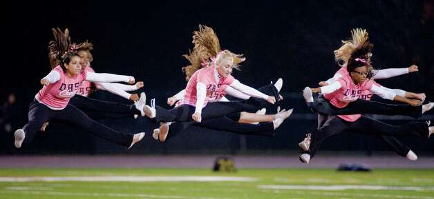 Danbury High School's cheerleaders performing at halftime during a game against Trumbull High School, played at Danbury. Friday, Oct. 26, 2012 Photo: Scott Mullin