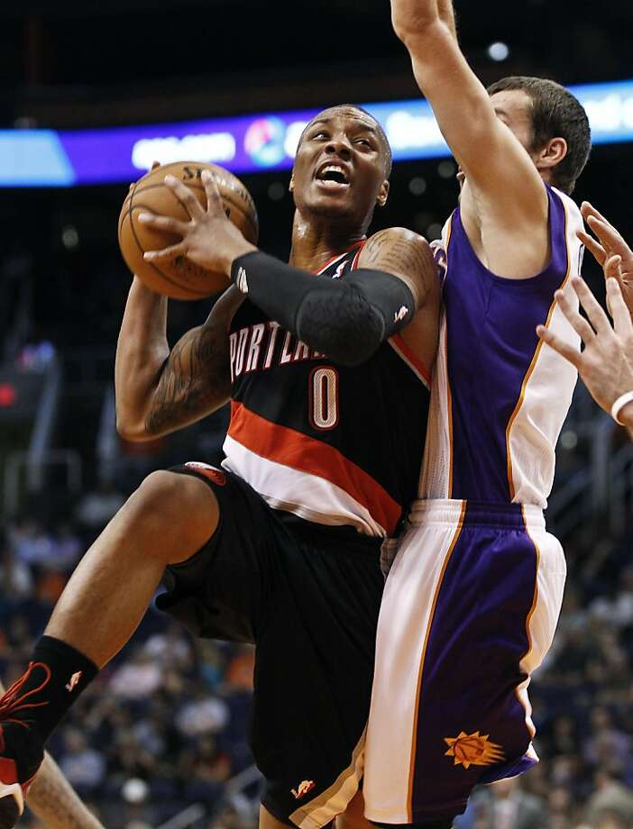 "Oakland High grad Damian Lillard (0) is seen as Portland's ""franchise point guard."" Photo: Ross Franklin, Associated Press"