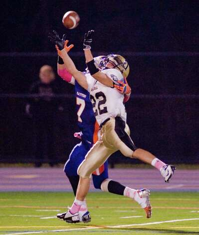 Trumbull High School's Liam Moore tries to make the reception during a game against Danbury High School, played at Danbury. Friday, Oct. 26, 2012 Photo: Scott Mullin