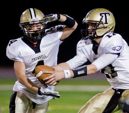 Trumbull High School's Marc Cesare takes the handoff from quarterback Nick Roberts during a game against Danbury High School, played at Danbury. Friday, Oct. 26, 2012 Photo: Scott Mullin