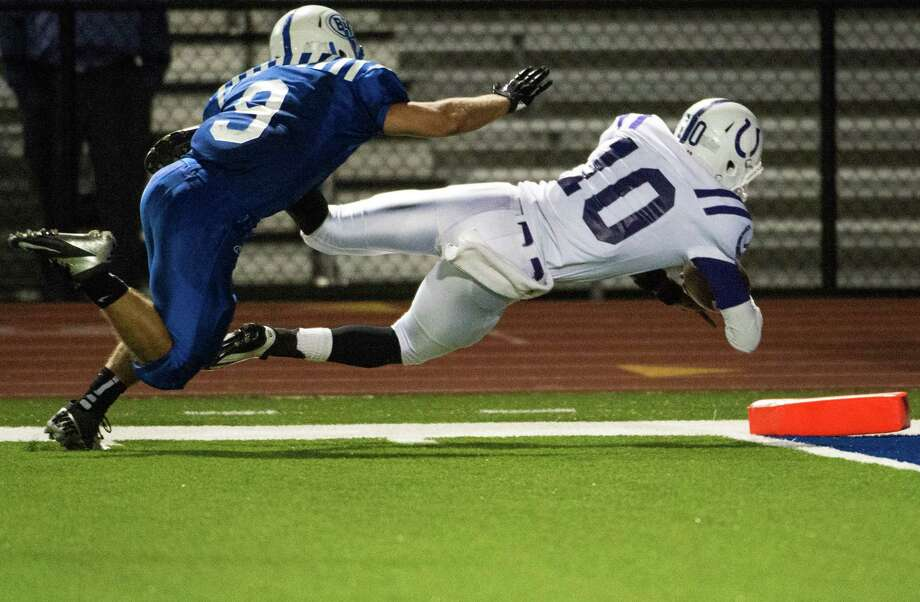 Quarterback Markain Chambers (10) went airborne to finish off his 39-yard run with a touchdown late in the fourth quarter of Dayton's win over Barbers Hill, which kept the Broncos undefeated. Photo: Smiley N. Pool, Staff / Houston Chronicle