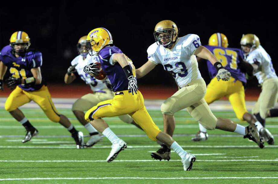 Troy's Pat Chamberlain (8), center, intercepts a pass and runs for a touchdown during their football game against Amsterdam on Friday, Oct. 26, 2012, at Troy High in Troy, N.Y. (Cindy Schultz / Times Union) Photo: Cindy Schultz / 00019849A