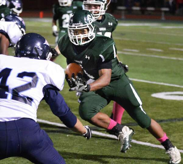 Shenendehowa's #1 Christie Marcelino runs the ball for a gain against Columbia during Friday night's