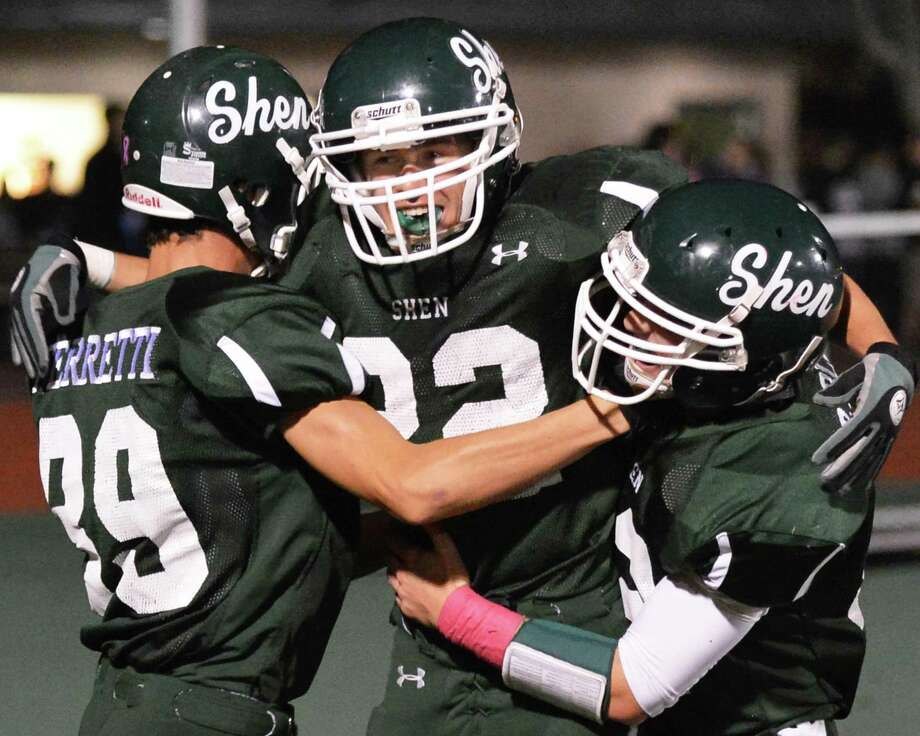 Shenendehowa's #22 Corey Acker, center is congratulated by team mates Vincent Ferretti, left, and Ryan Buss after scoring a touch during Friday night's game against Columbia High in Clifton Park  Oct. 26, 2012.  (John Carl D'Annibale / Times Union) Photo: John Carl D'Annibale / 00019850A