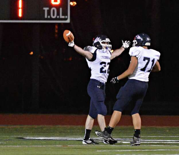 Columbia's #22 Chris Smith celebrates a touch down run with team mate Brad Tempel during Friday nigh