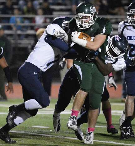 Shenendehowa's #32 Christopher Miller plows through two Columbia defenders during Friday night's game in Clifton Park  Oct. 26, 2012.  (John Carl D'Annibale / Times Union) Photo: John Carl D'Annibale / 00019850A