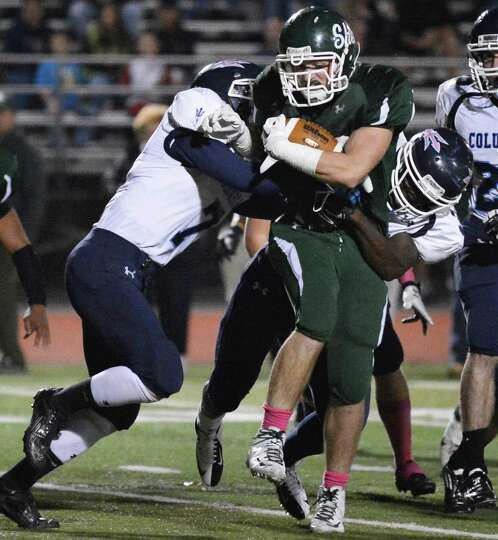 Shenendehowa's #32 Christopher Miller plows through two Columbia defenders during Friday night's gam