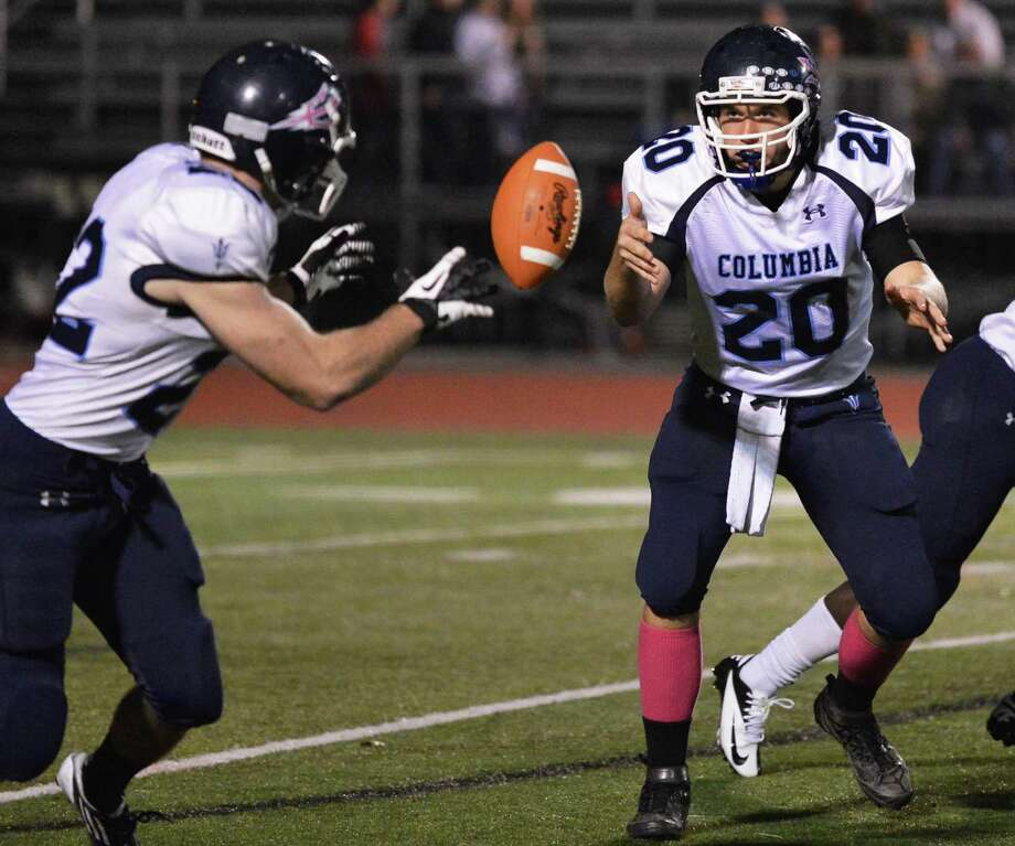 Columbia QB #20 Austin Lobban tosss the ball to #22 Chris Smith during Friday night's game against Shenendehowa in Clifton Park  Oct. 26, 2012.  (John Carl D'Annibale / Times Union) Photo: John Carl D'Annibale / 00019850A