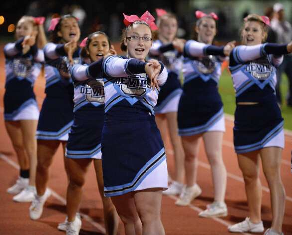 Evana Burke, i6, center, and members of the Columbia cheer squad during Friday night's game against Shenendehowa in Clifton Park  Oct. 26, 2012.  (John Carl D'Annibale / Times Union) Photo: John Carl D'Annibale / 00019850A