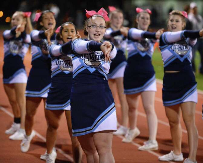 Evana Burke, i6, center, and members of the Columbia cheer squad during Friday night's game against