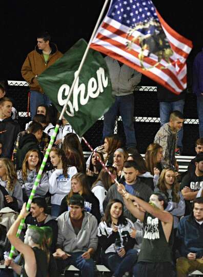 Shenendehowa fans wave flags as they cheer during Friday night's game with Columbia in Clifton Park