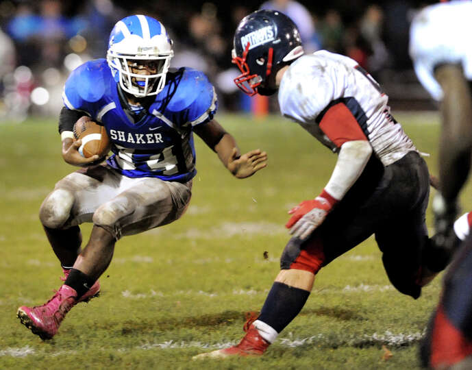 Shaker's Kenny Jackson (34), left, tries to avoid Schenectady's Jeremy Kent (5) during their footbal