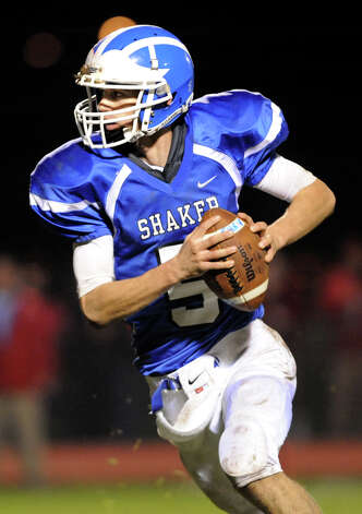 Shaker's quarterback Chris Landers (5) runs the ball during their football game against Schenectady on Friday, Oct. 26, 2012, at Shaker High in Latham, N.Y. (Cindy Schultz / Times Union) Photo: Cindy Schultz / 00019848A