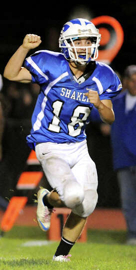 Shaker's Garrett McClenahan (18) celebrates when the defense stops Schenectady from scoring a touchd