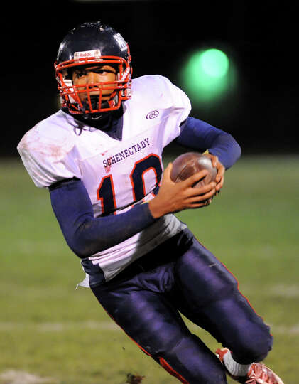 Schenectady's quarterback Kwame Jarvis (10) runs the ball during their football game against Shaker