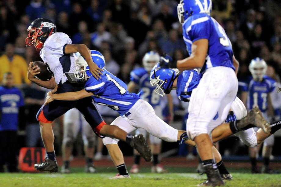 Schenectady's Hassan Rainey (7), left, gains yards as Shaker's Garrett McClenahan (18) defends during their football game on Friday, Oct. 26, 2012, at Shaker High in Latham, N.Y. (Cindy Schultz / Times Union) Photo: Cindy Schultz / 00019848A
