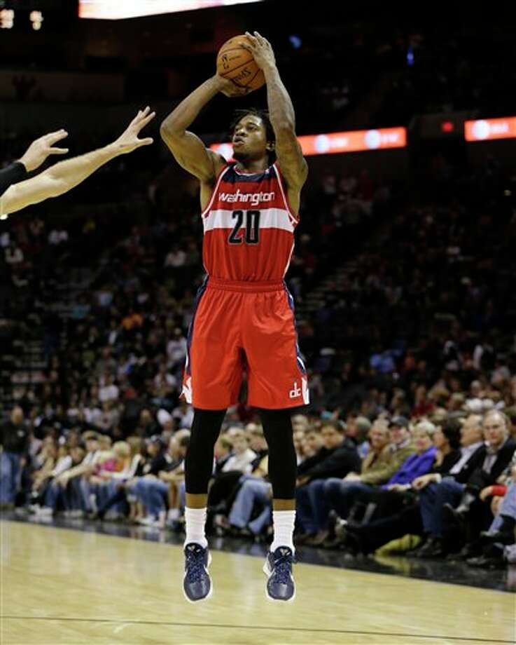 Washington Wizards' Cartier Martin shoots against during the fourth quarter of an preseason NBA basketball game against the San Antonio Spurs, Friday, Oct. 26, 2012, in San Antonio. (AP Photo/Eric Gay) Photo: Eric Gay, AP / AP