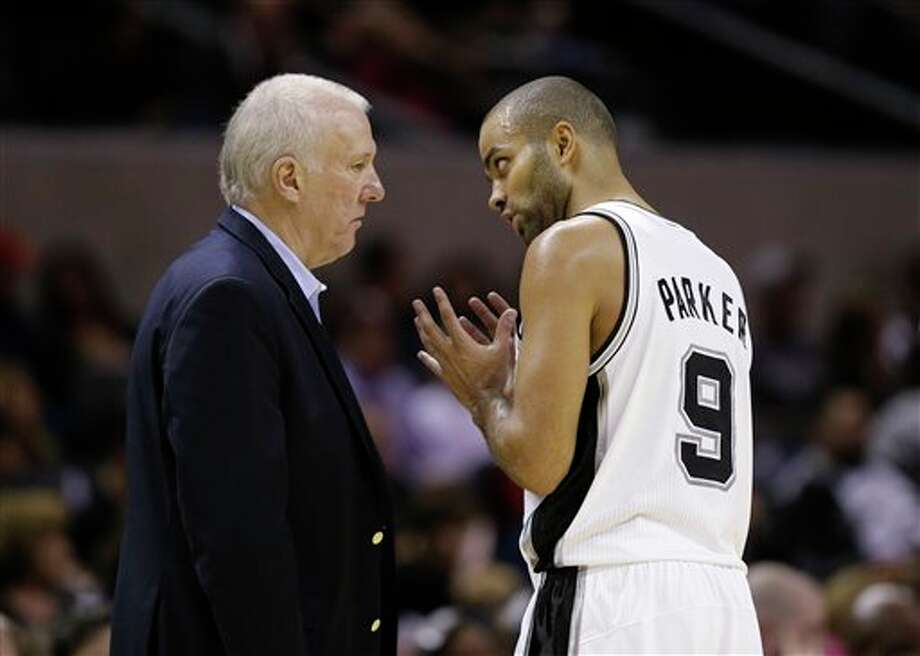 San Antonio Spurs' Tony Parker, right, of France, talks with coach Gregg Popovich, left, during the third quarter of an preseason NBA basketball game, Friday, Oct. 26, 2012, in San Antonio. (AP Photo/Eric Gay) Photo: Eric Gay, AP / AP