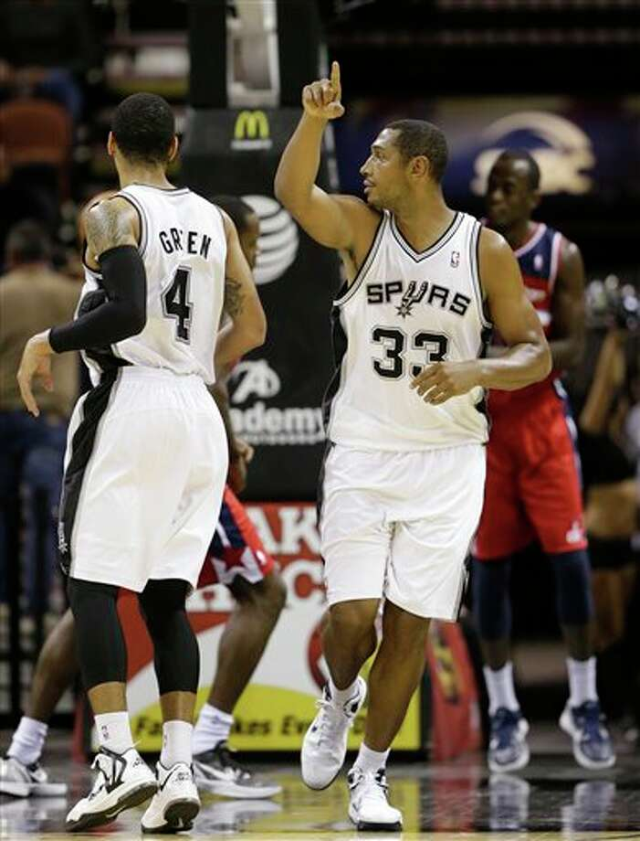 San Antonio Spurs' Boris Diaw (33), of France, signals during the third quarter of an preseason NBA basketball game against the Washington Wizards, Friday, Oct. 26, 2012, in San Antonio. (AP Photo/Eric Gay) Photo: Eric Gay, AP / AP