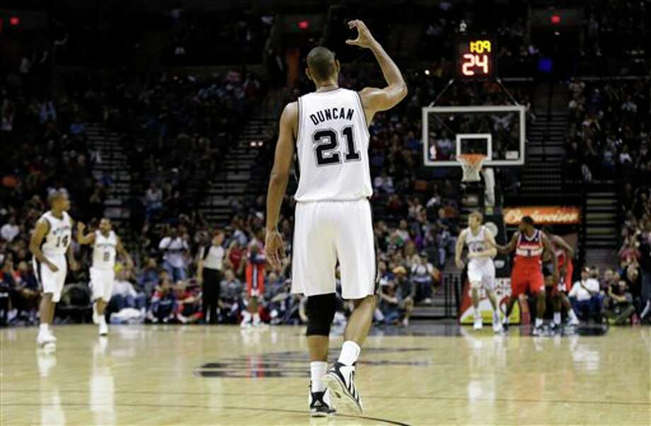 San Antonio Spurs' Tim Duncan (21) signals to teammates during the third quarter of an preseason NBA basketball game against the Washington Wizards, Friday, Oct. 26, 2012, in San Antonio. (AP Photo/Eric Gay) Photo: Eric Gay, AP / AP