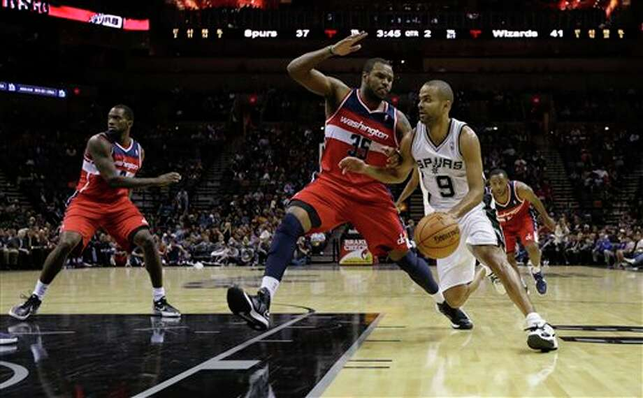 San Antonio Spurs' Tony Parker (9), of France, drives around Washington Wizards' Trevor Booker (35) during the second quarter of an preseason NBA basketball game, Friday, Oct. 26, 2012, in San Antonio. (AP Photo/Eric Gay) Photo: Eric Gay, AP / AP
