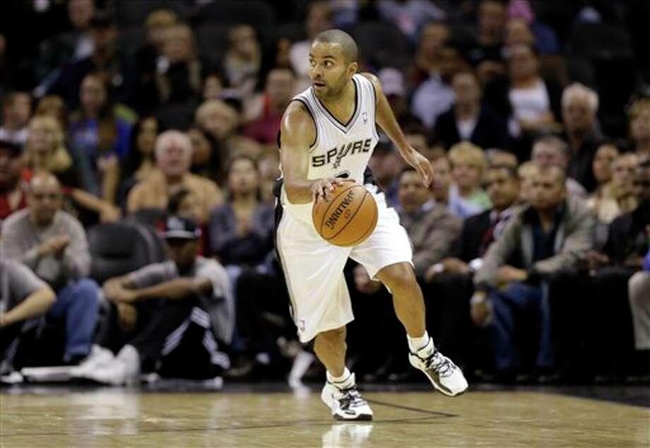 San Antonio Spurs' Tony Parker, of France, during the first quarter of an preseason NBA basketball game against the Washington Wizards, Friday, Oct. 26, 2012, in San Antonio. (AP Photo/Eric Gay) Photo: Eric Gay, AP / AP